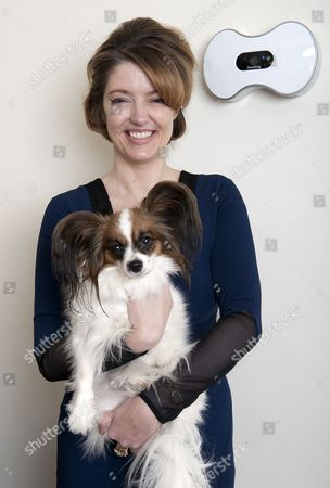Petronella Wyatt Tries The Smartdog Dog's Treats Dispenser At Home In London With Her Dog 'mini'.