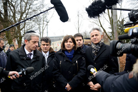Paris Mayor Anne Hidalgo, Deputy Mayor Patrick Klugman, Charlie Hebdo journalist Patrick Pelloux, Francois Zimeray ambassador of France in Denmark and Chief Rabbi Moise Lewin outside the Kruttonden cultural center, where the Ambassador survived a terrorist attack on Saturday