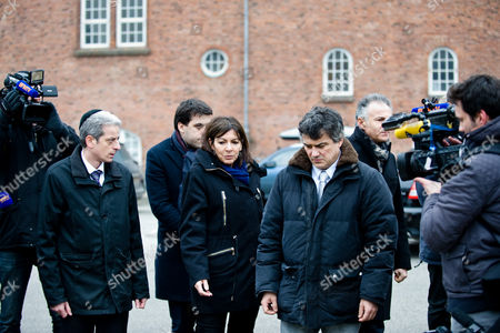 Paris Mayor Anne Hidalgo, Deputy Mayor Patrick Klugman, Charlie Hebdo journalist Patrick Pelloux, Francois Zimeray ambassador of France in Denmark and Chief Rabbi Moise Lewin hold a minute of silence outside Krudttonden cultural center to honor the victims of the Copenhagen shootings