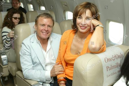 Terry Jastrow and Anne Archer aboard the chartered 737