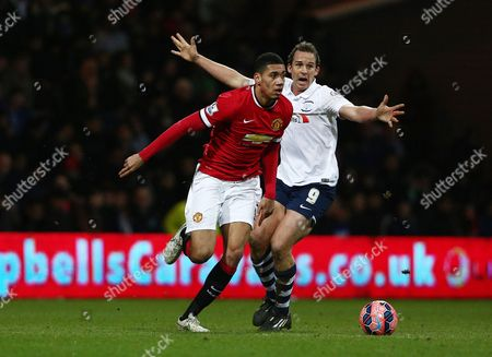 Chris Smalling of Manchester United and Kevin Davies of Preston North End