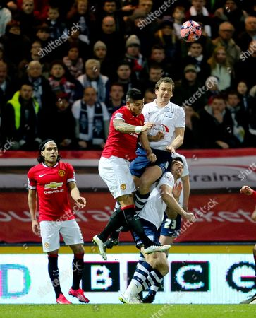 Marcos Rojo of Manchester United challenges Kevin Davies of Preston North End