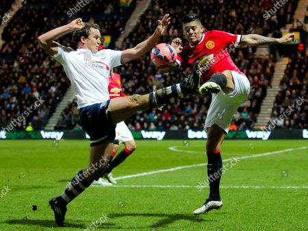 Kevin Davies of Preston North End goes in for a high challenge with Marcos Rojo of Manchester United