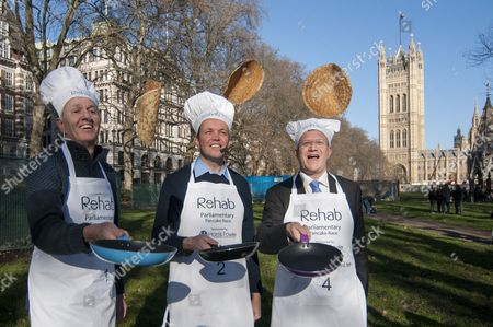 Nick de Bois, MP for Enfield North, David Burrowes, MP for Enfield, Southgate and Andrew Rosindell, MP for Romford of the Parliamentary Team practice a pancake toss.