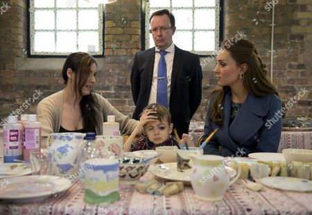 Britain's Catherine (R), Catherine Duchess of Cambridge, meets Sarah O'Sullivan (L) and her disabled 4-year-old son Daniel (C), as they decorate crockery during a visit at the 'Emma Bridgewater' pottery factory to view the production of a mug that the company has launched in support of East Anglia's Children's Hospices, in Stoke-on-Trent, Staffordshire