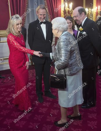 Queen Elizabeth II meets Mike Rutherford and his wife Angie Rutherford