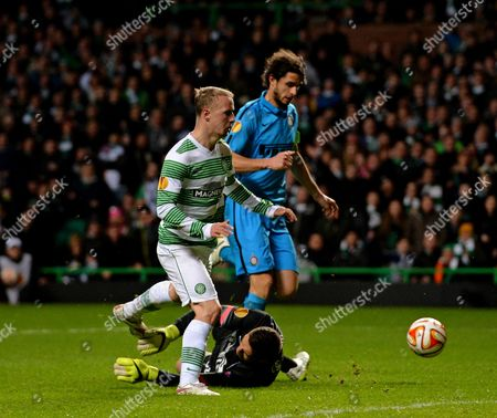 Leigh Griffiths of Celtic (centre) sees his shot saved by Juan Pablo Carrizo of Inter Milan