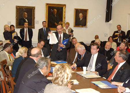 Stock Photo of Elliot Engel shows a document to Mayor Michael Bloomberg and other members of the New York delegation