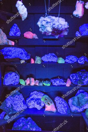 flourescent minerals glowing in ultra violet light at the Threlkeld mining museum, Lake District, UK.