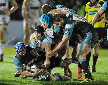 Glasgow's Josh Strauss retains posession from Ospreys Sam Davies and Justin Tipuric with Fraser Lyle in support