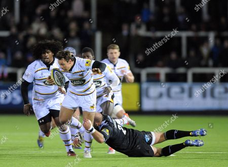 Rob Miller of Wasps tackled by Rob Hawkins of Newcastle Falcons