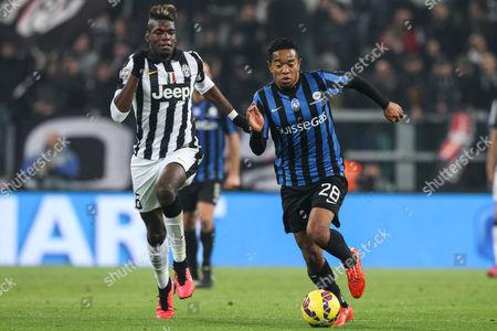 Atalanta midfielder Urby Emanuelson (28) vies with Juventus midfielder Paul Pogba (6)