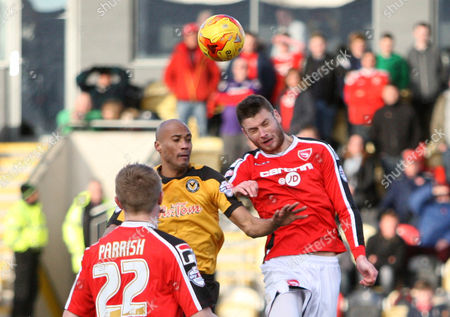 Chriz Zebroski of Newport County and Andrew Wright of Morecambe compete for the ball