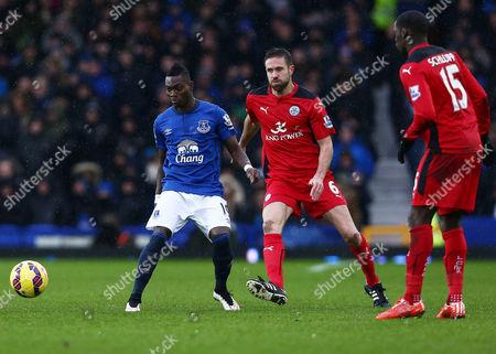 Christian Atsu of Everton and Matthew Upson of Leicester City