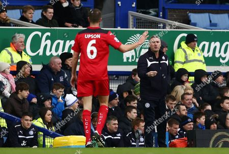 Leicester City manager Nigel Pearson reacts behind Matthew Upson