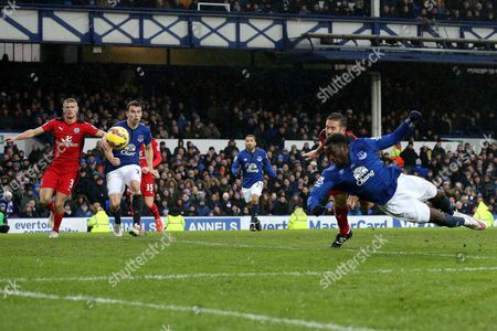 Matthew Upson of Leicester City scores an own goal to make the score 2-2