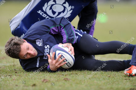 Chris Cusiter - Scotland scrum half lays the ball back during rucking practice.