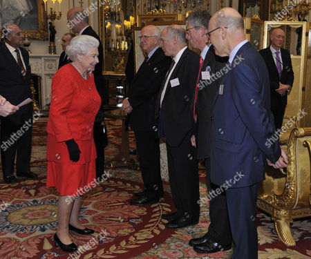 Queen Elizabeth II, accompanied by Prince Philip, is greeted by (left to right) Lord Dyson, Chairman, Magna Carta Trust, Sir Robert Worcester, Chairman, Magna Carta 800th Trust, Lord Neuberger, Professor Robert Hazell and Joshua Rozenberg
