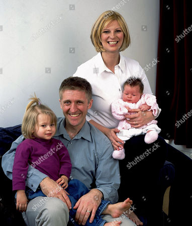 LAUREN BOOTH WITH HUSBAND CRAIG DARBY AND DAUGHTERS HOLLY AND ALEXANDRA