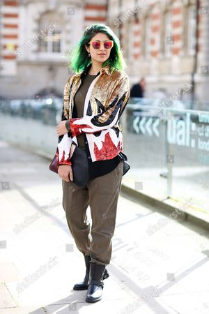 Editorial image of Street Style at Autumn Winter 2015, London Fashion Week, Britain - 24 Feb 2015