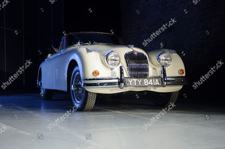 Vintage (1950s) cream XK series Jaguar sports car used in the production