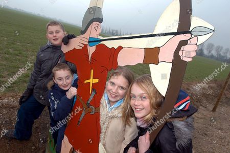 Tom Morris, Jack Kerr, Amber Mylchreest and Rachel Friday, pupils from the Centre Verginiaud, on the battlefield of Agincourt