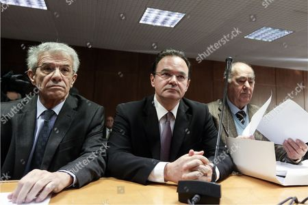 Former Greek finance minister Giorgos Papakonstantinou   (C) with his solicitors
