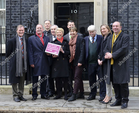 David Amess, Mark Pritchard, Peter Tatchell, Jim Dowd, Angela Smith, Russell Whiting, Caroline Lucas, Stanley Johnson, Tracey Crouch, and Norman Baker deliver a petition calling for a ban on the use of wild animals in the circus