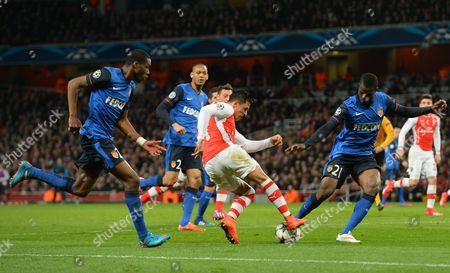 Alexis Sanchez of Arsenal is tackled by Elderson Uwa Echiejile of AS Monaco