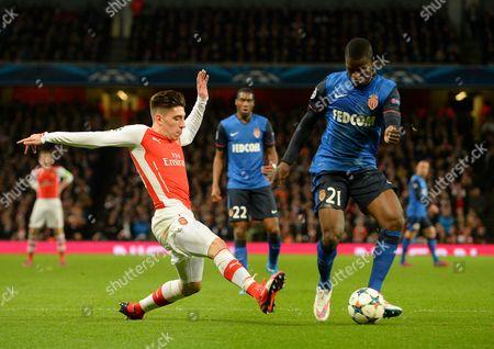 Arsenal's Hector Bellerin tries to tackle Elderson Uwa Echiejile of AS Monaco