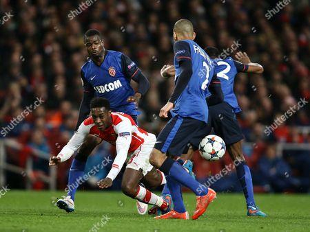 Danny Welbeck of Arsenal is fouled by Elderson Echiejile of AS Monaco