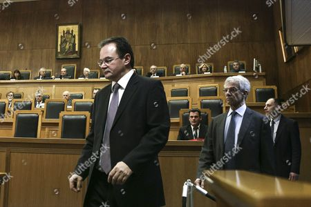 Stock Photo of Former Greek finance minister Giorgos Papakonstantinou enters the court followed by his lawyers