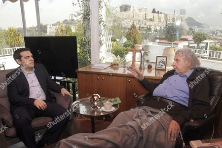 Greek Prime Minister Alexis Tsipras speaks with Composer and former politician, Mikis Theodorakis at his home