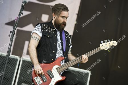 Castle Donington United Kingdom - June 13: Bassist Dan Pugsley Of Welsh Hard Rock Group Skindred Performing Live On The Stephen Sutton Main Stage At Download Festival On June 13