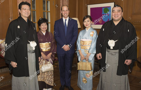 Prince William with sumo master Isegehama Junko and wife Munkhjargal and newly-crowned sumo grand champion Harumafuji Kohei at the British Embassy in Tokyo