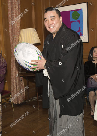 Newly-crowned sumo grand champion Harumafuji Kohei has a go at Rugby at a reception at the British Embassy in Tokyo
