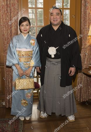 Newly-crowned sumo grand champion Harumafuji Kohei and his wife Munkhjargal attend a reception at the British Embassy in Tokyo