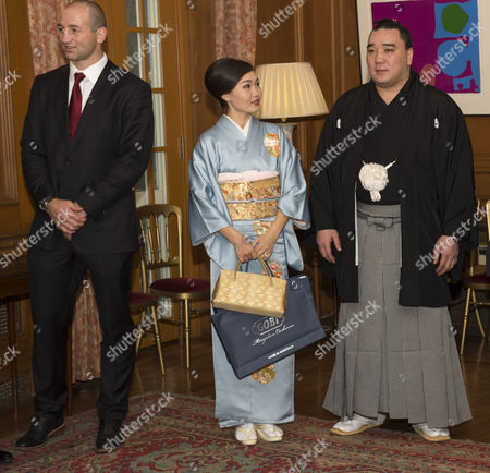 Steve Borthwick, newly-crowned sumo grand champion Harumafuji Kohei and his wife Munkhjargal at the British Embassy in Tokyo