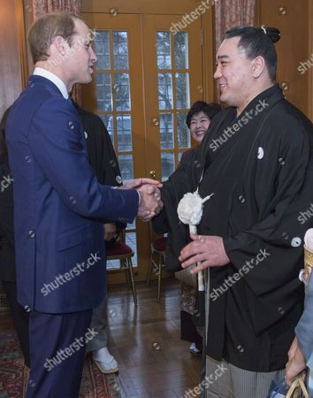 Prince William meets newly-crowned sumo grand champion Harumafuji Kohei at a reception at the British Embassy in Tokyo
