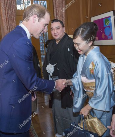 Newly-crowned sumo grand champion Harumafuji Kohei and his wife Munkhjargal meet Prince William at the British Embassy in Tokyo