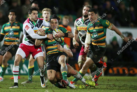 Kahn Fotuali'i of Northampton Saints is tackled by Ollie Lindsay-Hague of Harlequins.