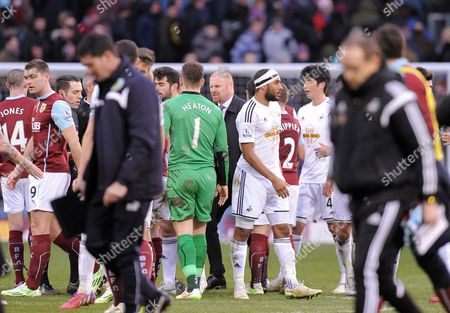 Stock Photo of Manager Sean Dyche of Burnley confronts the referee J Moss at the final whistle