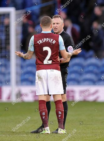 Kieran Trippier of Burnley argues with referee J Moss at the end of the game