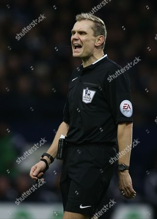 Stock Image of 4th official Graham Scott replaced injured  Phil Dowd at the half time