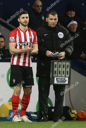 Shane Long of Southampton and Referee Phil Dowd as a 4th official