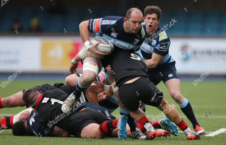 Cardiff Blues Lou Reed is tackled by Edinburgh's Grayson Hart