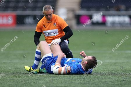 Scott Anderson of Wakefield Trinity Wildcats receives treatment to an injury on his right knee