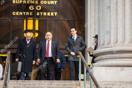 Michael Lohan Jr. (R) with his lawyer Ravi Batra (red tie) leaving the New York State Supreme Courthouse
