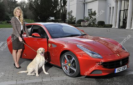 Launch Of The New Ferrari Ff. A Super Car With A Big Enough Boot To Carry A Dog. Pic Shows:- Model Kirsty Heslewood With Five-year-old Labrador 'jake' And The Ferrari Ff At Coworth Park Ascot Berks.