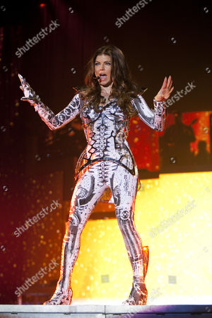 Singer Stacy Ann Ferguson, Fergie, of the U.S. Hip-Hop band The Black Eyed Peas live at the Hallenstadion Oerlikon stadium, Zurich, Switzerland